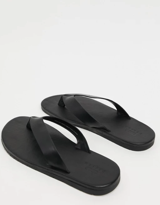 "<br><br><strong>ASOS DESIGN</strong> Flip Flops in Black Leather, $, available at <a href=""https://www.asos.com/asos-design/asos-design-flip-flops-in-black-leather/prd/14583105?affid=25897&_Cj0KCQiAhP2BBhDdARIsAJEzXlFFaeZgTQIrfZavEB_qEIxzqhzzz4bKQrL1DZu6_K3IDFKOE46xgHIaAugBEALw_wcB&channelref=product+search&ppcadref=12029787983%7c117574734673%7cpla-294682000766&gclid=Cj0KCQiAhP2BBhDdARIsAJEzXlFFaeZgTQIrfZavEB_qEIxzqhzzz4bKQrL1DZu6_K3IDFKOE46xgHIaAugBEALw_wcB&gclsrc=aw.ds"" rel=""nofollow noopener"" target=""_blank"" data-ylk=""slk:ASOS"" class=""link rapid-noclick-resp"">ASOS</a>"