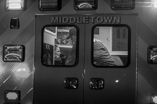 """<p>The Middletown Fire Department responds to a call about a woman possibly overdosing on heroin. """"You're not going to get in trouble:"""" A fireman tries to convince her to go to the hospital. (Photograph by Mary F. Calvert for Yahoo News) </p>"""