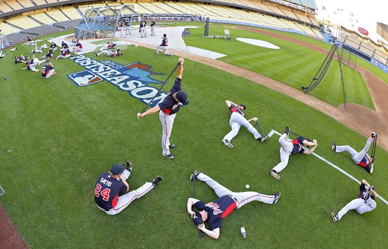 Members of the Atlanta Braves warm up during practice in preparation for Game 3 of the National League division series against the Los Angeles Dodgers, Saturday, Oct. 5, 2013, in Los Angeles. (AP Photo/Mark J. Terrill)