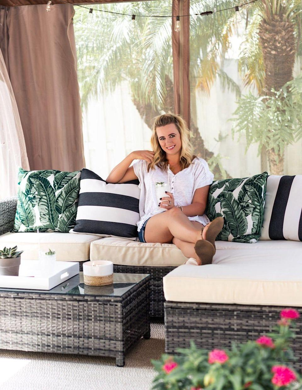 """<p>Create an outdoor oasis in your backyard with some string lights and palm leaf print pillows. A comfortable rattan sectional makes this gazebo the perfect place for lounging or hosting friends and family. </p><p><strong>Get the look at <a href=""""https://thefancythings.com/2018/09/our-backyard-reveal/"""" rel=""""nofollow noopener"""" target=""""_blank"""" data-ylk=""""slk:Fancy Things"""" class=""""link rapid-noclick-resp"""">Fancy Things</a>. </strong></p><p><a class=""""link rapid-noclick-resp"""" href=""""https://www.amazon.com/HGOD-DESIGNS-Decorative-Outdoor-Standard/dp/B07DJCJMTY/?tag=syn-yahoo-20&ascsubtag=%5Bartid%7C10050.g.30932979%5Bsrc%7Cyahoo-us"""" rel=""""nofollow noopener"""" target=""""_blank"""" data-ylk=""""slk:SHOP OUTDOOR PALM LEAF PILLOWS"""">SHOP OUTDOOR PALM LEAF PILLOWS</a></p>"""
