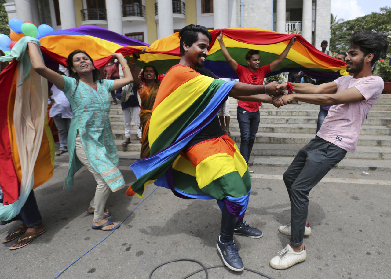 <p>Members of the LGBT community dance to celebrate after the country's top court struck down a colonial-era law that made homosexual acts punishable by up to 10 years in prison, in Bangalore, India, Thursday, Sept. 6, 2018. The court gave its ruling Thursday on a petition filed by five people who challenged the law, saying they are living in fear of being harassed and prosecuted by police. (AP Photo/Aijaz Rahi) </p>