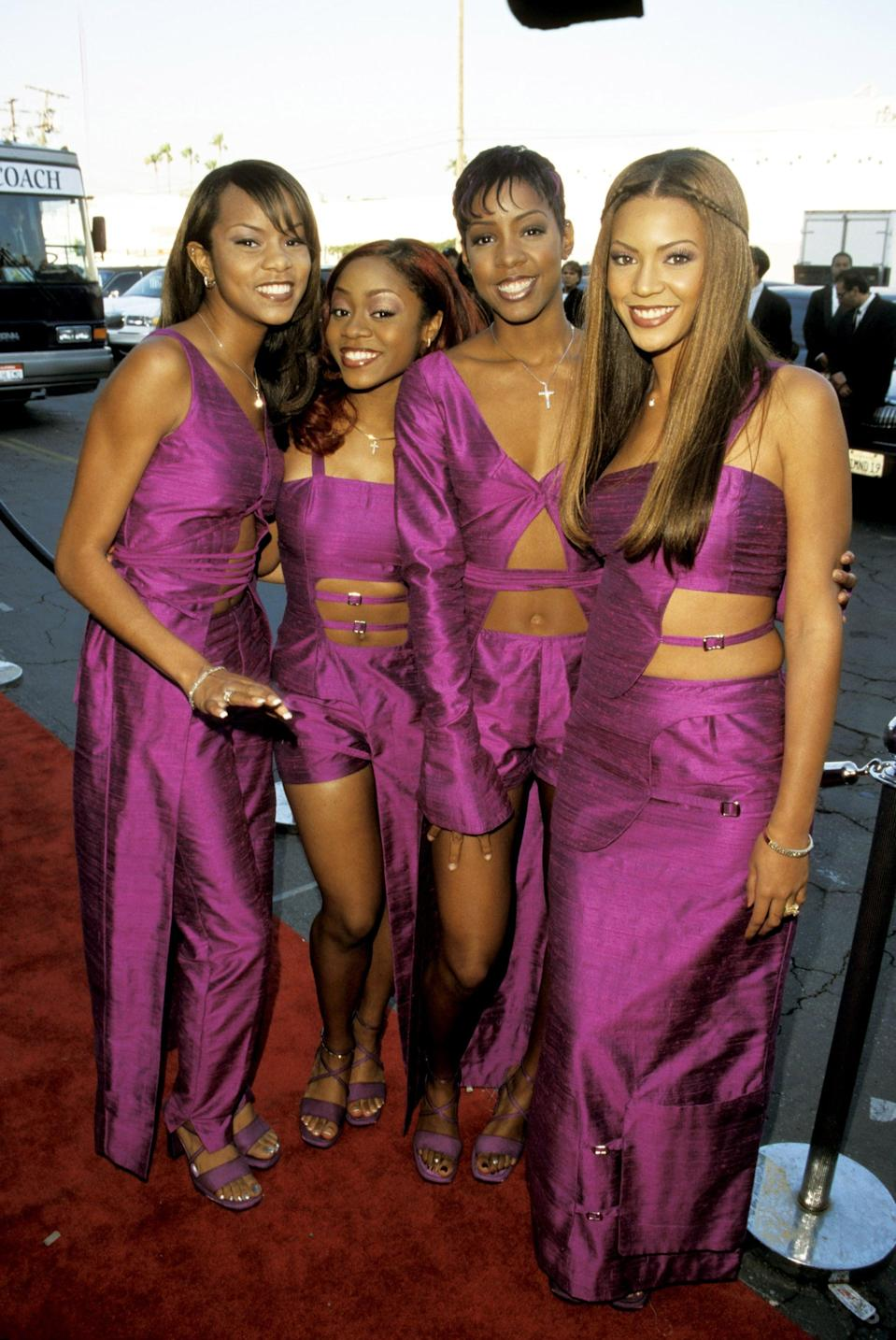 <p>At the 1999 Soul Train Music Awards wearing variations of a purple cutout outfit.</p>