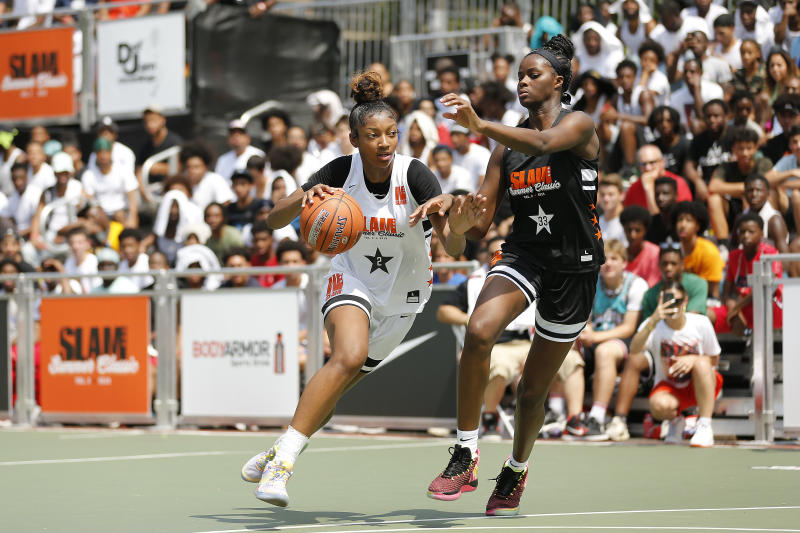 NEW YORK, NEW YORK - AUGUST 18: Angel Reese #2 drives to the basket during the SLAM Summer Classic 2019 girls game at Dyckman Park on August 18, 2019 in New York City. (Photo by Michael Reaves/Getty Images)