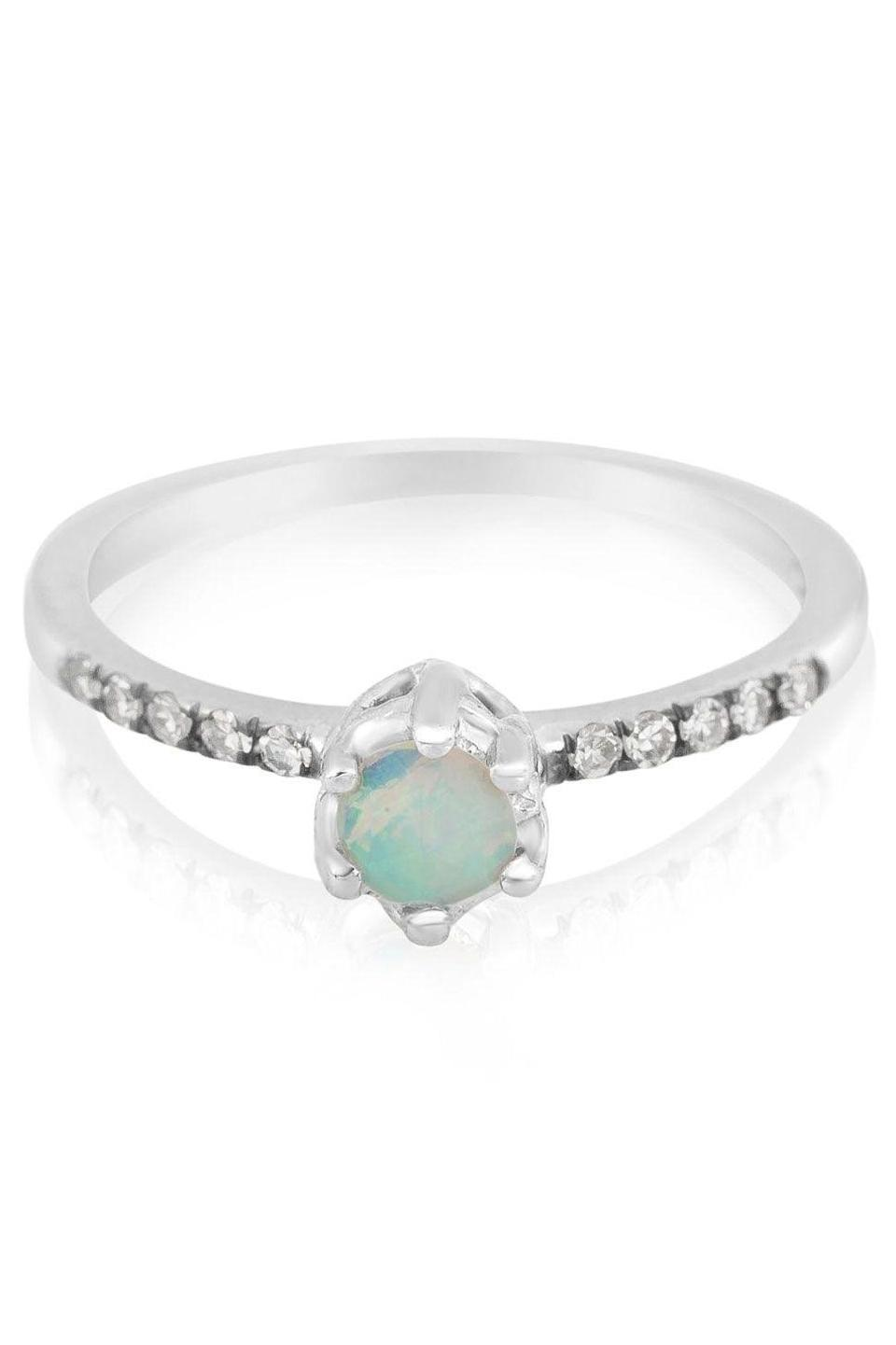 """<p><strong>Maniamania</strong> Opal Entity Solitaire Ring, $1,800, available at <a href=""""http://www.stoneandstrand.com/jewelry/rings/opal-entity-solitaire-ring-14k-gold-white-diamond-opal"""" rel=""""nofollow noopener"""" target=""""_blank"""" data-ylk=""""slk:Stone & Strand"""" class=""""link rapid-noclick-resp"""">Stone & Strand</a>.</p>"""