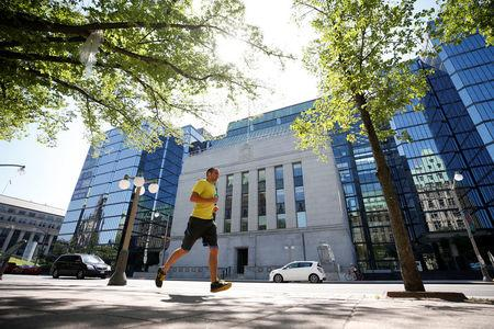 A jogger runs past the Bank of Canada building in Ottawa