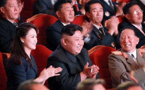 Kim sat with his wife Ri at the galaCredit: AFP