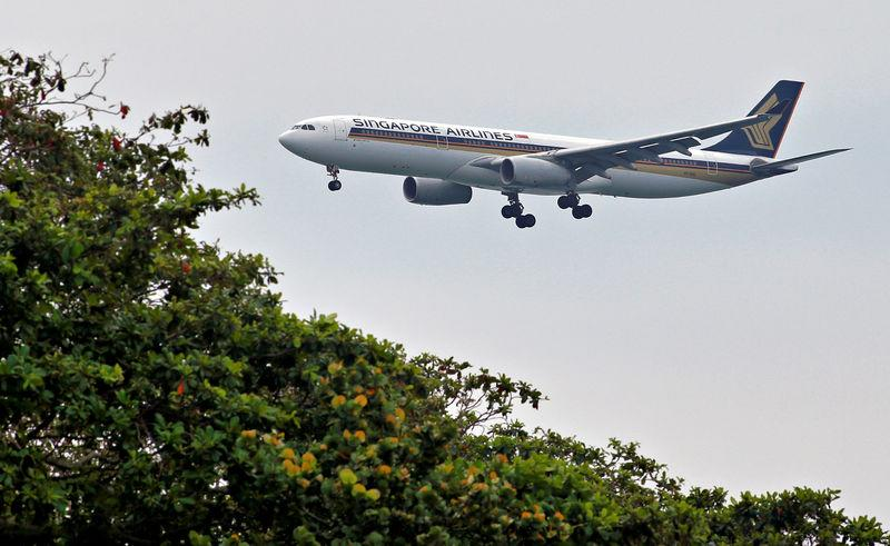 FILE PHOTO: A Singapore Airlines Airbus A330 airplane approaches to land at Changi International Airport in Singapore