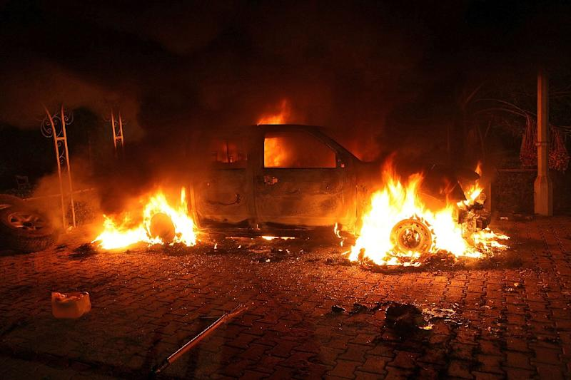 A vehicle and the surrounding area are engulfed in flames after it was set on fire inside the US consulate compound in Benghazi, Libya on September 11, 2012 (AFP Photo/STR / STR)