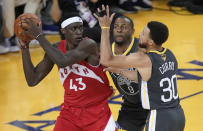Toronto Raptors forward Pascal Siakam (43) is defended by Golden State Warriors forward Andre Iguodala (9) and guard Stephen Curry (30) during the first half of Game 4 of basketball's NBA Finals in Oakland, Calif., Friday, June 7, 2019. (AP Photo/Tony Avelar)