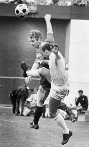 FILE - In this Sept. 28, 1968, file photo, Atlanta Chiefs' forward Peter McParland, rear, heads the ball past San Diego Toros' fullback Miroslav Milovanovic (2) during the North American Soccer League championship game in Atlanta. Fifty years ago, in a fitting bit of symmetry, an upstart soccer team in a fledgling league gave an up-and-coming city a reason to cheer. The Atlanta Chiefs won the very first title in the North American Soccer League, beating the San Diego Toros 3-0 before a crowd of about 15,000 at Atlanta Stadium. (AP Photo/File)