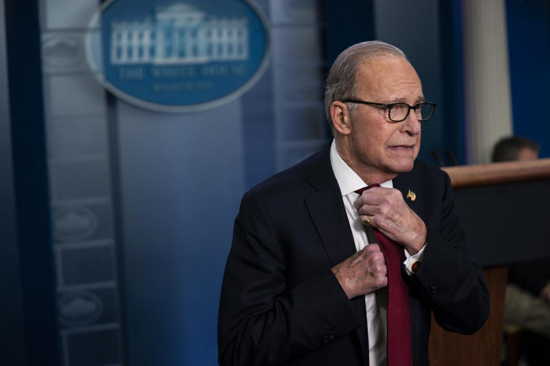 White House chief economic adviser Larry Kudlow adjusts his tie before speaking with reporters about the impact of the Coronavirus on markets in the Brady Press Briefing Room of the White House, Friday, Feb. 28, 2020, in Washington. (AP Photo/Evan Vucci)