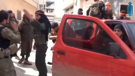 A still image taken from a video uploaded on social media on March 22, 2017, purports to show Tahrir al-Sham rebel fighters getting into a pick-up truck, said to be in Soran district, near Hama, Syria. Social Media Website via Reuters TV ATTENTION EDITORS - THIS IMAGE HAS BEEN SUPPLIED BY A THIRD PARTY. IT IS DISTRIBUTED, EXACTLY AS RECEIVED BY REUTERS, AS A SERVICE TO CLIENTS. NO THIRD PARTY SALES. NOT FOR USE BY REUTERS THIRD PARTY DISTRIBUTORS. FOR EDITORIAL USE ONLY. NO RESALES. NO ARCHIVES.
