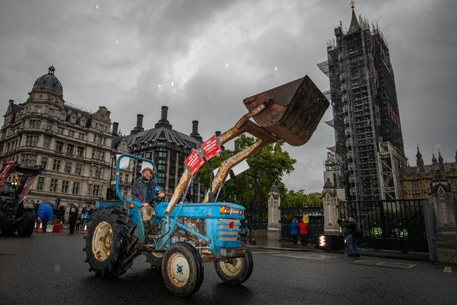 Farmers in tractors take part in a protest over food and farming standards, organised by Save British Farming, at Westminster, London