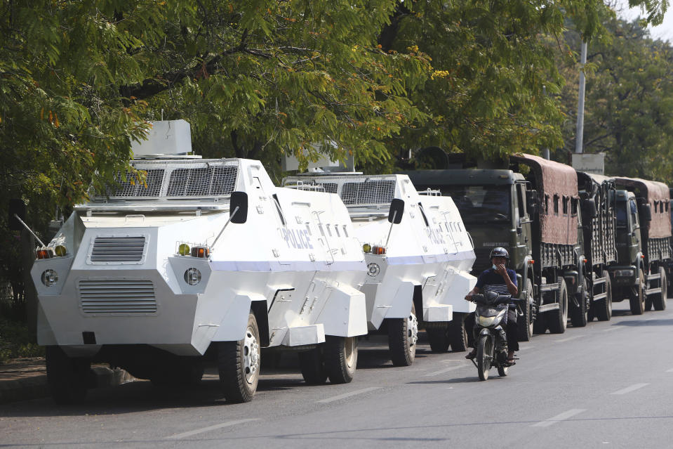 Police armed vehicles park along a main road after protesters were dispersed in Mandalay, Myanmar, Friday, Feb. 26, 2021. In the country's second-largest city, anti-coup protesters took to the streets Friday. By midday, security forces had blocked the main road in downtown Mandalay to prevent the protesters from gathering. (AP Photo)