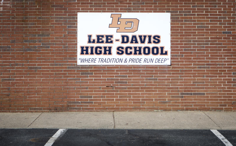 """MECHANICSVILLE, VA - MARCH 3, 2018: A sign on the side of Lee-Davis High School reads, """"Where Tradition and Pride Run Deep,"""" in Mechanicsville, Virginia on March 3, 2018. (Photo by Julia Rendleman for the Washington Post)"""