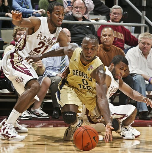 Florida State's Michael Snaer (21) and Georgia Tech's Mfon Udofia (0) and Florida State's Jeff Peterson (12) go for a loose ball in the second half of an NCAA college basketball game on Wednesday, Feb. 1, 2012, in Tallahassee, Fla. Florida State won 68-54. (AP Photo/Phil Sears)