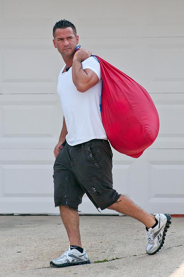 "Unfortunately, Mike ""The Situation"" Sorrentino couldn't help out since he was busy doing the ""L"" (laundry) in his GTL routine. Rumor has it that The Situation has followed in his roomie Vinny Guadagnino's footsteps and has headed home early. ""Mike walked off the show. He's so over the whole thing,"" a source tells <i>Us Weekly</i>. ""I don't think he's coming back. Everyone in the house is so unhappy."" Thelonius/<a href=""http://www.splashnewsonline.com"" target=""new"">Splash News</a> - July 6, 2011"