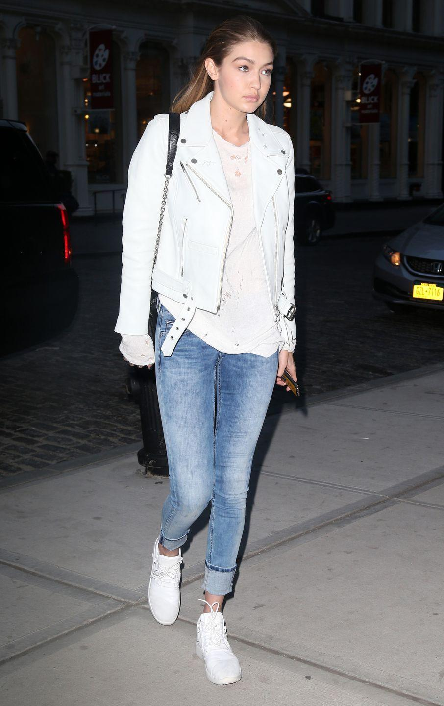 <p>Hadid brought denim and leather into spring, pairing a custom Neuw leather jacket with lighter hues and bright white kicks. </p>