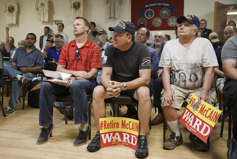 Veterans listen as Kelli Ward speaks during a campaign stop at the Veterans of Foreign Wars Post 720 in Phoenix on Aug. 11, 2016. (Bloomberg via Getty Images)
