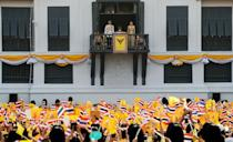 Thailand's newly crowned King Maha Vajiralongkorn and Queen Suthida are seen at the balcony of Suddhaisavarya Prasad Hall at the Grand Palace where King grants a public audience to receive the good wishes of the people in Bangkok, Thailand May 6, 2019.REUTERS/Jorge Silva