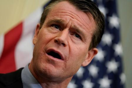 FILE PHOTO - Sen. Todd Young (R-IN) speaks at a news conference about the Tobacco to 21 Act, which would raise the minimum age to buy tobacco products and e-cigarettes to 21, on Capitol Hill