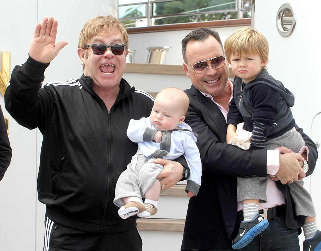 UK pop singer Elton John and his husband David Furnish with their babies spotted in Venice, Italy.