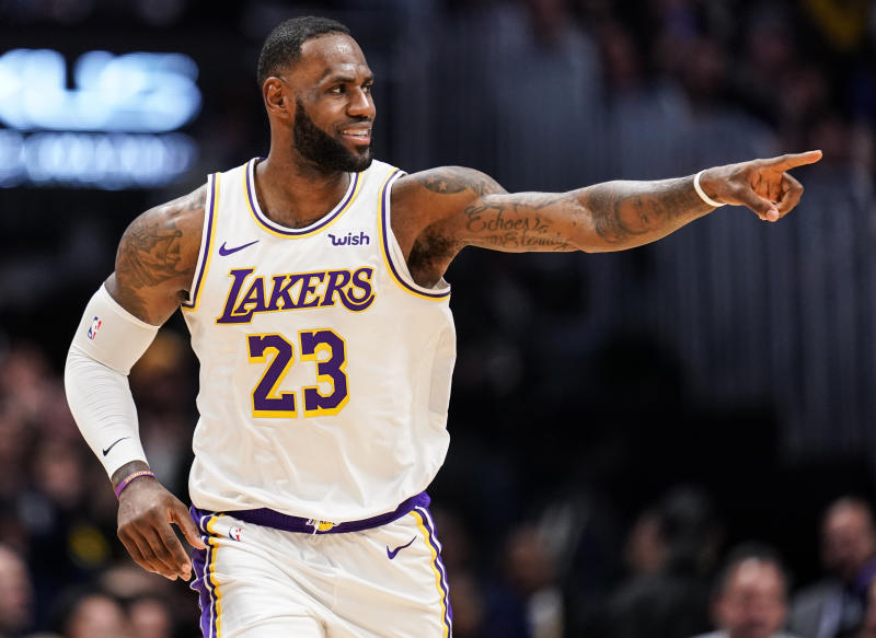 Los Angeles Lakers forward LeBron James celebrates a basket during the second half of the team's NBA basketball game against the Denver Nuggets on Tuesday, Dec. 3, 2019, in Denver. The Lakers won 105-96. (AP Photo/Jack Dempsey)