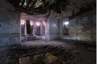 <p>Stained glass windows fill this decrepit space with a beautiful hue.</p>