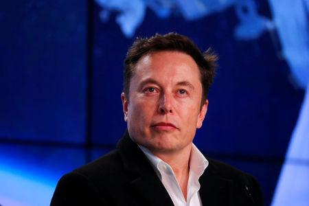FILE PHOTO:  Musk looks on at SpaceX Falcon 9 post-launch news conference in Cape Canaveral