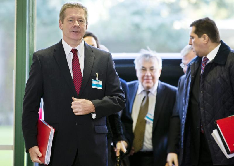 Russian deputy Foreign Minister Gennady Gatilov arrives for a meeting with UN Joint Special Representative for Syria Lakhdar Brahimi and U.S. Under Secretary of State for Political Affairs Wendy Sherman, to find a politic solution to the crisis in Syria, at the European headquarters of the United Nations, in Geneva, Switzerland, Monday, November 25, 2013. (AP Photo/Keystone, Salvatore Di Nolfi)
