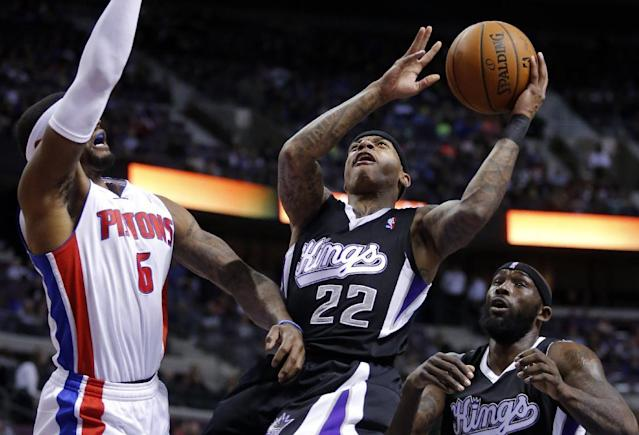Sacramento Kings guard Isaiah Thomas (22) goes to the basket against Detroit Pistons forward Josh Smith (6) as Kings forward Royce White, right, looks on during the first half of an NBA basketball game, Tuesday, March 11, 2014, in Auburn Hills, Mich. (AP Photo/Duane Burleson)