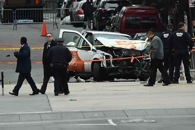 Investigators work around the wreckage of a Home Depot pickup truck a day after it was used in a terror attack in New York on November 1, 2017.