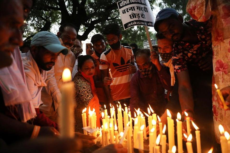 People attend a candlelight vigil to protest against the alleged rape and murder of a 9-year-old girl in New Delhi, India (REUTERS)