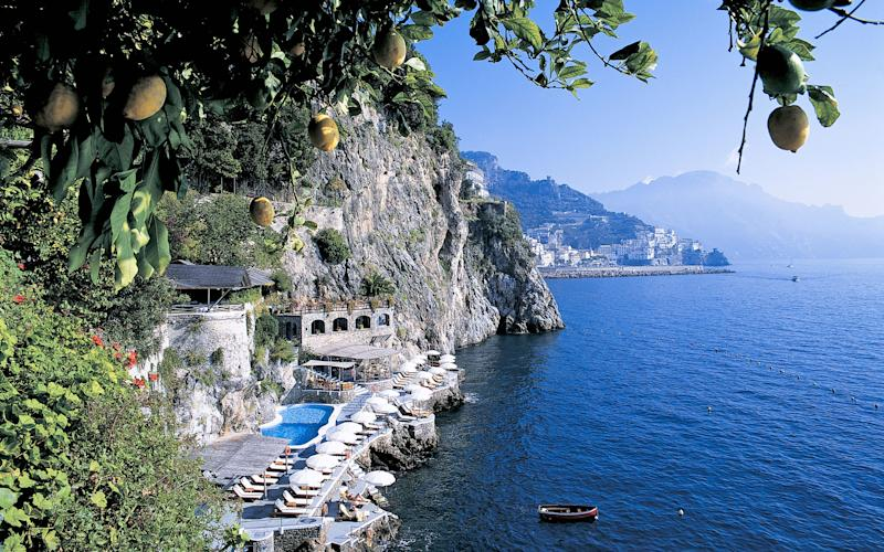 Lemon trees frame a view of Santa Caterina Hotel on the Amalfi Coast