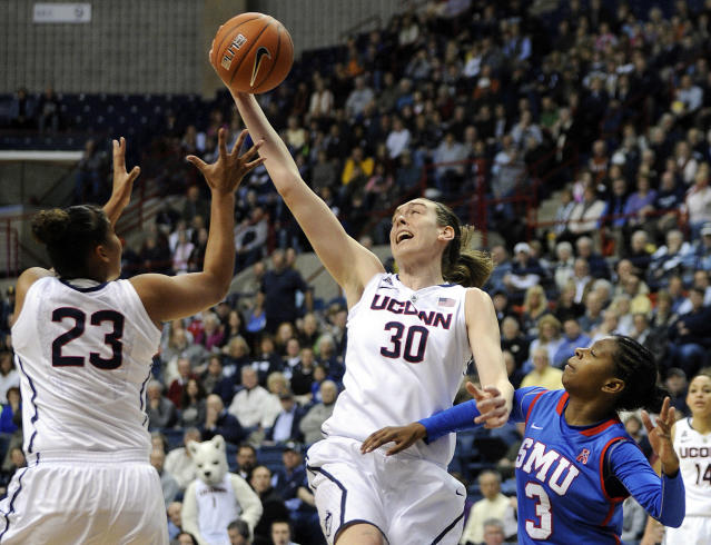 Connecticut's Breanna Stewart (30) grabs a rebound as teammate Kaleena Mosqueda-Lewis (23) and SMU's Gabrielle Wilkins (3) look on during the first half of an NCAA college basketball game in Storrs, Conn., Tuesday, Feb. 4, 2014. (AP Photo/Fred Beckham)