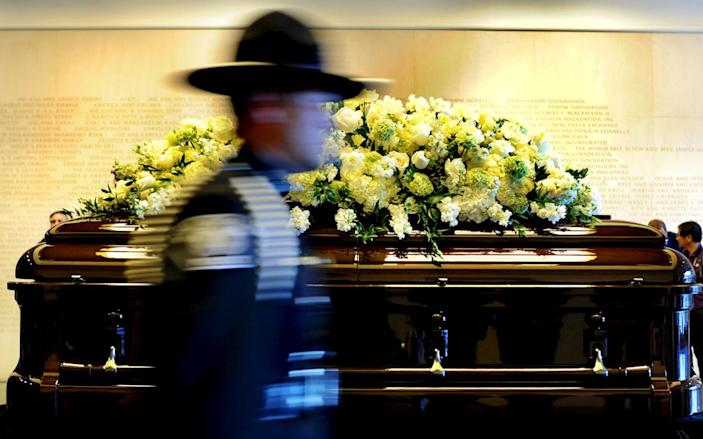 <p>A police officer walks by the casket of former first lady Nancy Reagan as she lies in repose at the Ronald Reagan Presidential Library, in Simi Valley, Calif., March 9, 2016. <i>(Photo: Wally Skalij/Reuters)</i><br></p>