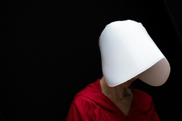 "Another major TV hit of the 2010s was ""The Handmaid's Tale"" -- the dystopian drama that sparked a new way for women to protest around the world, wearing the iconic white bonnets and red dressed seen in the Hollywood version of Gilead"
