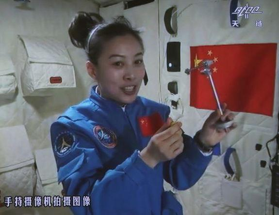 This screengrab from television taken on June 20, 2013 shows female astronaut Wang Yaping, one of the three crew members of Shenzhou-10 spacecraft, giving a lecture to students on Earth aboard China's space module Tiangong-1.
