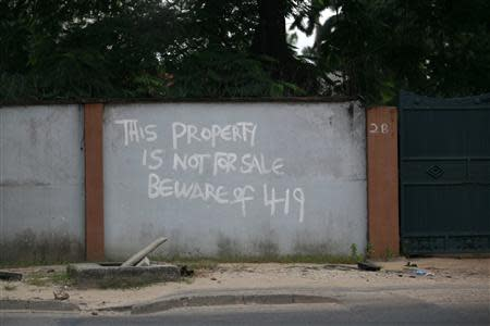 A warning sign is seen on the boundary wall of a house in the Ikoyi district in Nigeria's commercial capital Lagos