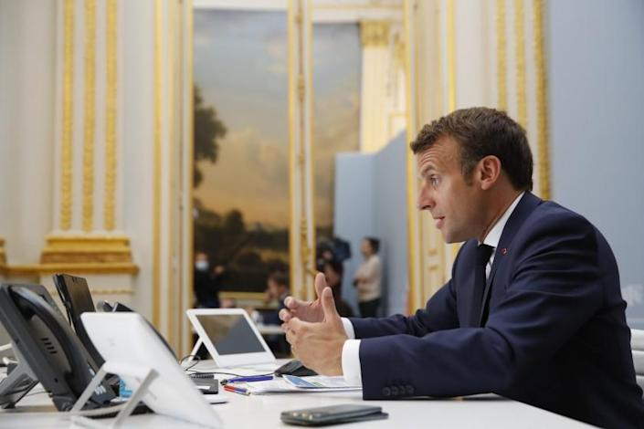 """French President Emmanuel Macron speaks with Tedros Adhanom Ghebreyesus, Director General of the World Health Organization and other world leaders about the coronavirus outbreak during a video conference at the Elysee Palace Friday, April 24, 2020 in Paris. Emmanuel Macron urged leaders of the world's biggest economies to """"show the world that it's possible to succeed when we are all together and unite our forces."""" (AP Photo/Christophe Ena, Pool)"""