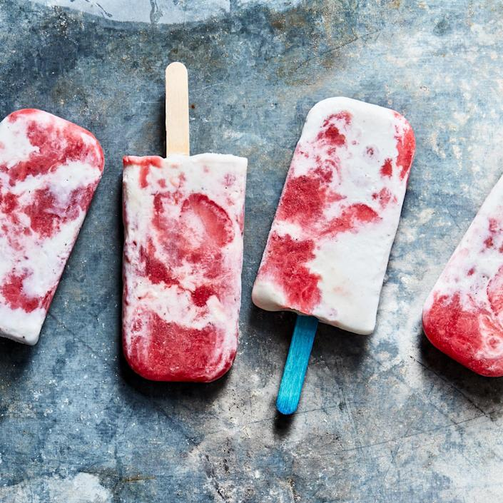 <p>A glossy compote made from strawberries swirled with softened frozen yogurt gives these pops Creamsicle vibes.</p>