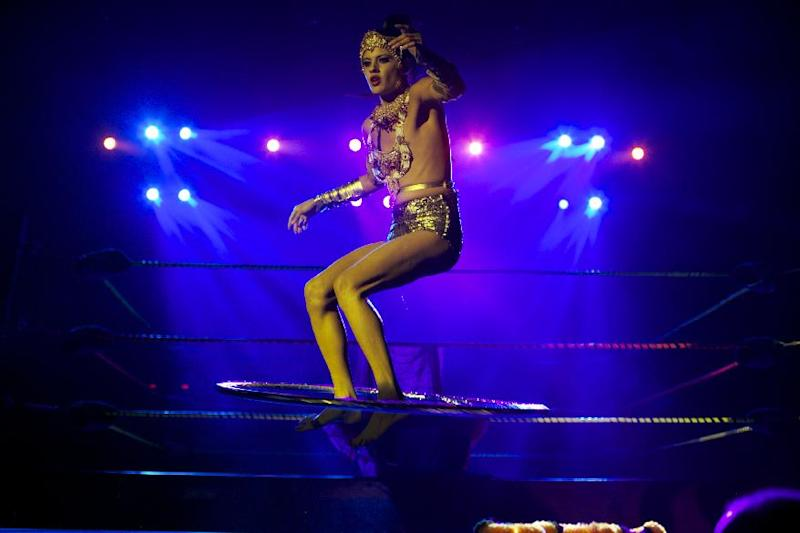 In this Wednesday, Feb. 12, 2014 photo, burlesque dancer Karis Wilde, a male dancer who performs in drag, performs at Lucha VaVoom's Valentine's show at The Mayan Theatre downtown Los Angeles. (AP Photo/Damian Dovarganes)