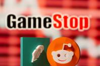 3d printed Robinhood and Reddit logos are seen in front of displayed GameStop logo