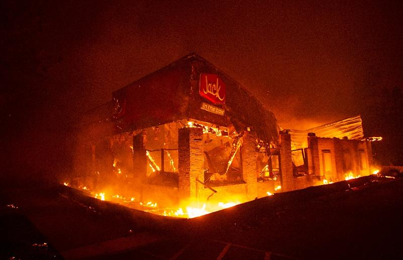 A Jack In The Box fast food restaurant burns as the Camp fire tears through Paradise, north of Sacramento, California on November 08, 2018 (AFP Photo/Josh Edelson)