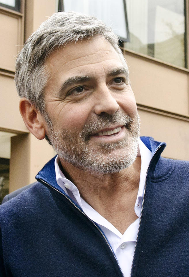 "With all his exotic vacations and the younger ladies on his arm, Hollywood A-lister George Clooney is glamorous and gorgeous — but he's also gray! The 51-year-old explained his choice to go au naturel in an interview with <em>Playboy</em> magazine. ""You don't want to try to look younger because you'll look wrong,"" he said. ""You dye your hair, you look wrong. You wear a bad toupee, you look wrong. You wear makeup to hide things, you get your eyes done, you look wrong."" Clearly, Clooney's doing something right! (3/16/2012)"