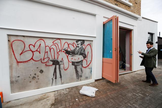 The Banksy mural known as The Painter was unveiled in Notting Hill, London (Picture: Reuters)
