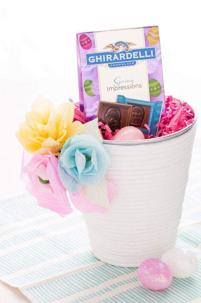 """<p>Transform a cheap pail into a sweet Easter basket with your choice of craft paint and paper flowers. </p><p><a href=""""http://www.brit.co/rope-bucket-easter-baskets/"""" rel=""""nofollow noopener"""" target=""""_blank"""" data-ylk=""""slk:Get the tutorial from Brit & Co. »"""" class=""""link rapid-noclick-resp""""><em>Get the tutorial from Brit & Co. »</em></a></p>"""