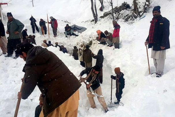 PHOTO: Local residents search for victims in the snow after an avalanche in Neelum Valley in the Pakistan-controlled portion of Kashmir on Jan. 15, 2020. (STR/AFP via Getty Images)