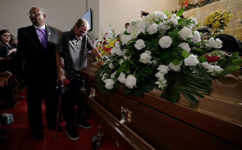Antonio Basco places his hand on the casket of his wife Margie Reckard during her prayer service Friday, Aug. 16, 2019. at La Paz Faith Center in El Paso, Texas. She was one of the 22 people killed in the Walmart mass shooting on Aug. 3, 2019.