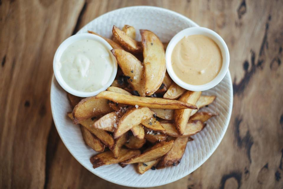 "<p>Baked french fries are simple, especially if you have an air fryer, but if you're craving real, crispy, greasy french fries, you're better off just getting takeout or going the frozen route. </p><p>""A bag of good quality frozen fries saves you time and money in a restaurant. That theory holds true at home as well,"" <a href=""http://chefdavidsantos.com/"" rel=""nofollow noopener"" target=""_blank"" data-ylk=""slk:Chef David Santos"" class=""link rapid-noclick-resp"">Chef David Santos</a> of <a href=""http://umsegredony.com/"" rel=""nofollow noopener"" target=""_blank"" data-ylk=""slk:Um Segredo Supper Club"" class=""link rapid-noclick-resp"">Um Segredo Supper Club</a> tells Woman's Day. ""Making amazing french fries takes time and effort and it's a skill you should definitely know. However the trade off between quality and time is marginal in my opinion, especially today when there are so many well made frozen fries on the market.""</p>"